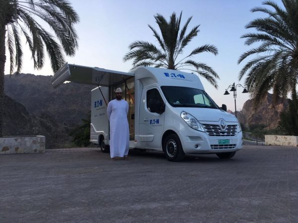 Eaton InfoWheels roadshow in the Middle East surrounded by palm trees
